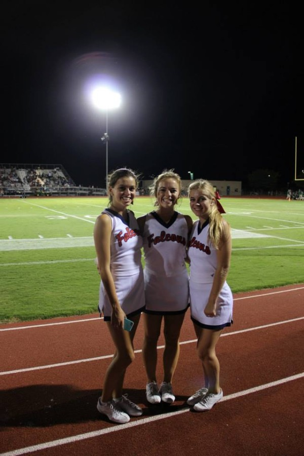 From left: Kennedy Stovall '15, Nina Cloven '16, and Whitney Kelly '16 take a quick picture while cheering at the first football game at Lake Worth on August 30th.