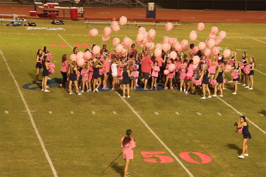 Breast+cancer+survivors+and+their+families+were+honored+during+the+halftime+of+the+Falcon+varsity+football+game+versus+Holland+Hall+in+October.