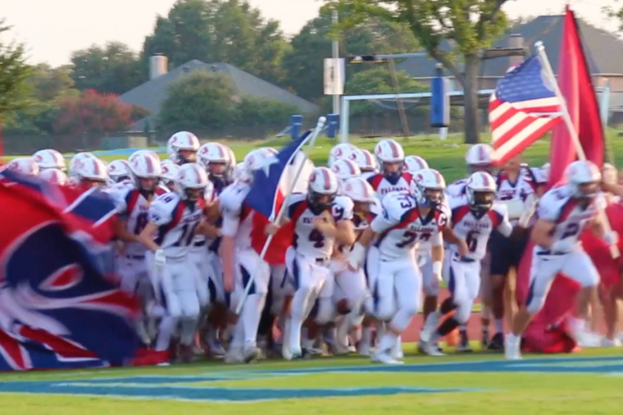 The+Falcons+rush+the+field+for+the+start+of+the+Battle+of+Bryan+Irvin+game+against+Trinity+Valley+School+on+September+2.