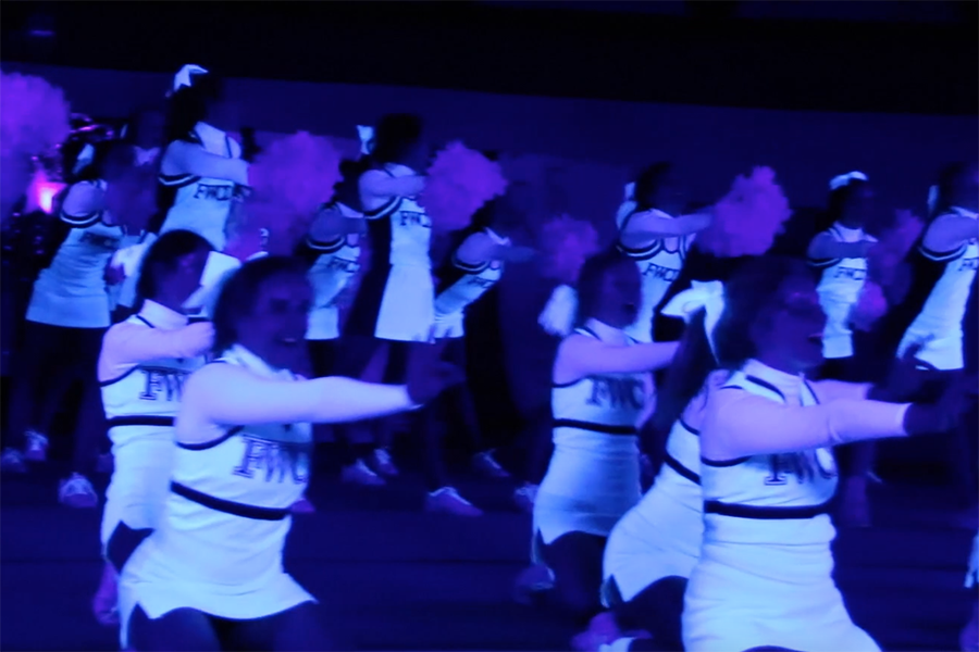 Varsity and JV cheer squads performed their recent pep rally in the dark.