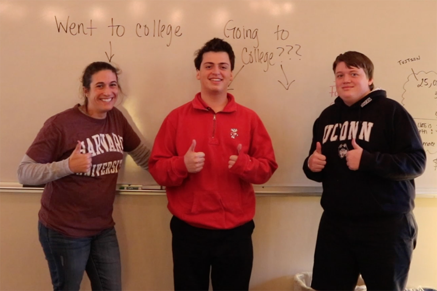 US history teacher Sara Teegarden, Isaac Narrett '17 and Edward Martin '17 support the college fair by sporting college sweatshirts.