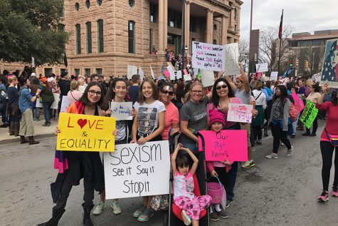 Christi Alvear marches with daughters and friends in Sundance Square.