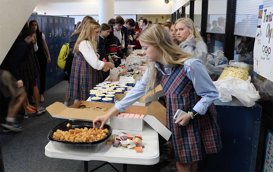 Bridget Chambers '18 helps the Cooking for a Cause group with their quarterly bake sale.