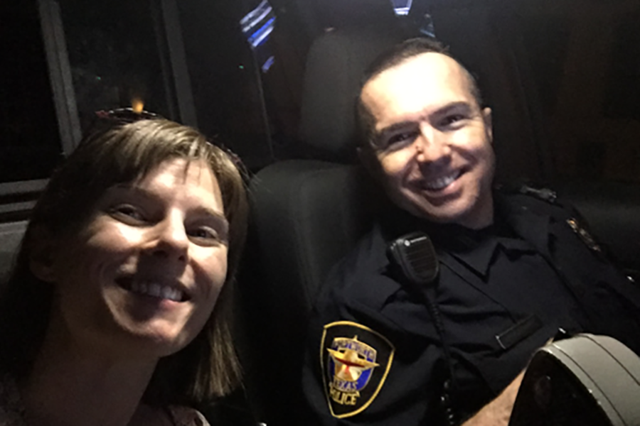 US art teacher Lauren Cunningham and Fort Worth Police Officer Armendiaz take a selfie during Cunningham's ride-in experience.