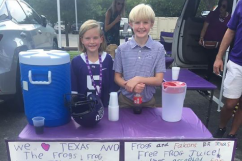 FWCD middle school students sell lemonade at a local TCU football game to raise funds for Hurricane Harvey relief.