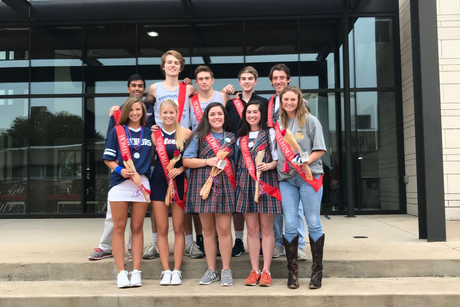 The 2017 homecoming court poses on the steps of the martin center after the pep rally