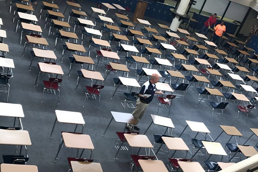 Teachers+line+up+desks+in+the+US+commons%2C+where+finals+are+traditionally+held.+