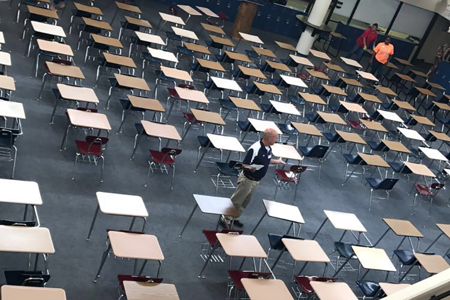 Teachers line up desks in the US commons, where finals are traditionally held.