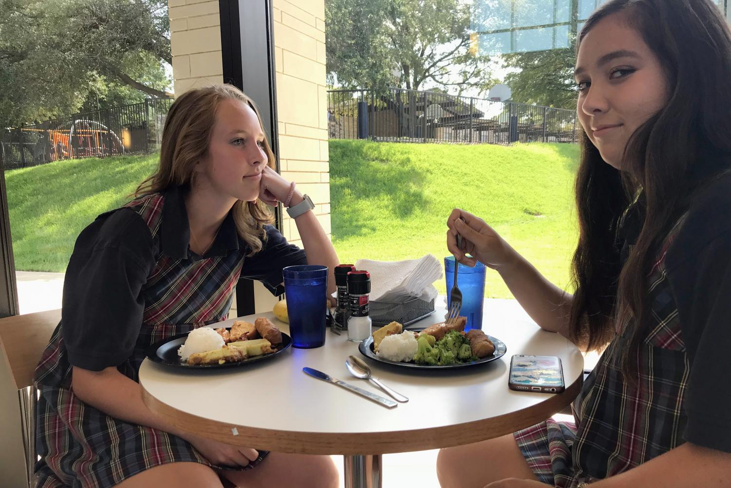 Seniors Virginia Sanders and Elena Casement eat lunch in the FDP. Seniors only have off campus privileges on Thursdays and Fridays.