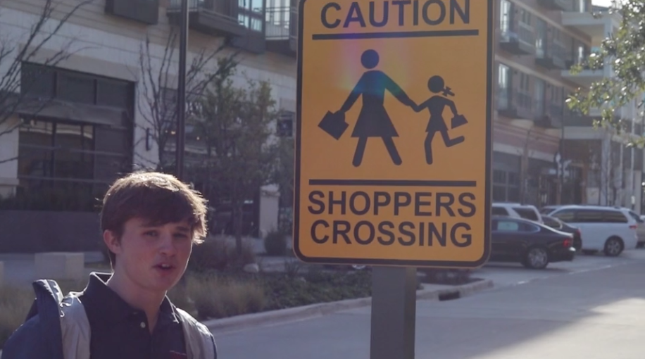 Ben Dike '19 warns viewers about the shoppers crossing in The Shops at Clearfork.