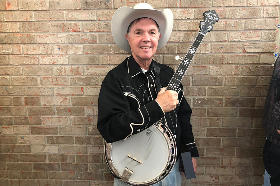 Mr. Bloch plays the banjo in the 50th annual Kindergarten Rodeo.