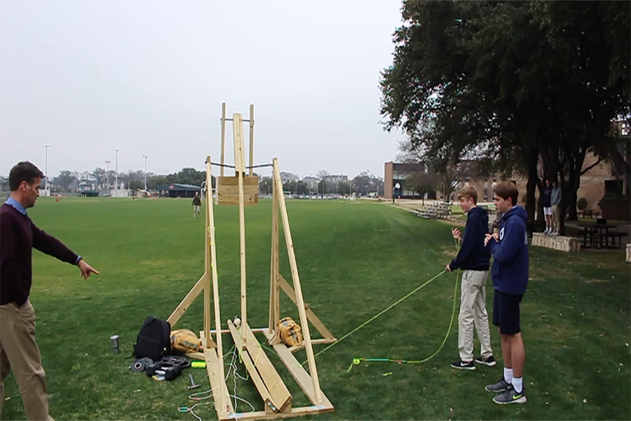 Aiden Meeker '19 and Dillon Flynn '19 prepare to launch their catapult.
