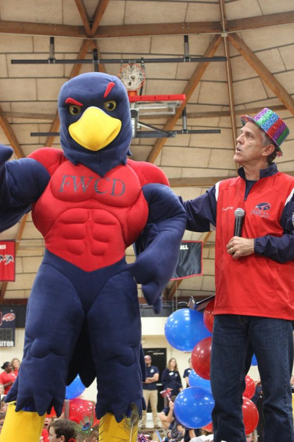 The new falcon joined Head of School Eric Lombardi on stage at the 2019 Convocation.