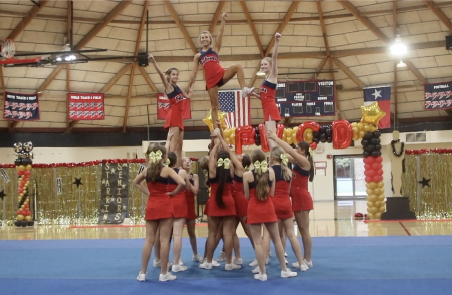 Cheerleaders+performed+a+Hollywood-themed+cheer+routine+at+the+pep+rally.