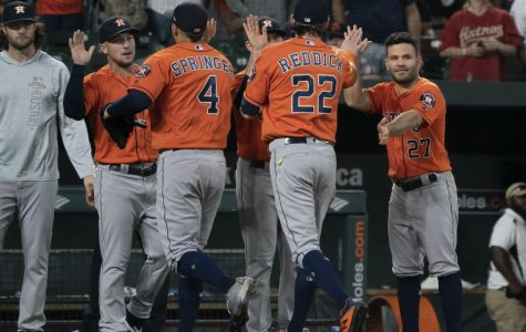 Astros players celebrate together during a 2018 game.