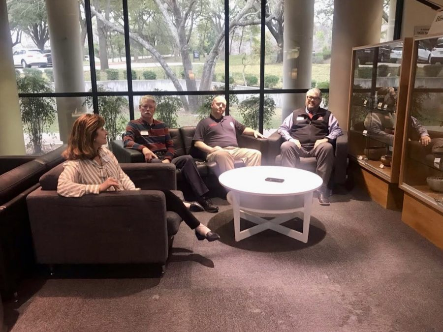 Therea Fuss, LS Counselor; Craig Slatyon, Head of Security; Andrew Beasley, Network Administrator; and Chad Peacock, Security Supervisor met in the library to film a video, which was shown on Founders' Day.