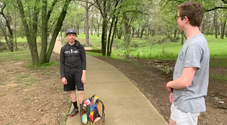 Ned Newton '20 interviews an avid disc golfer at Sorona Park in Fort Worth.