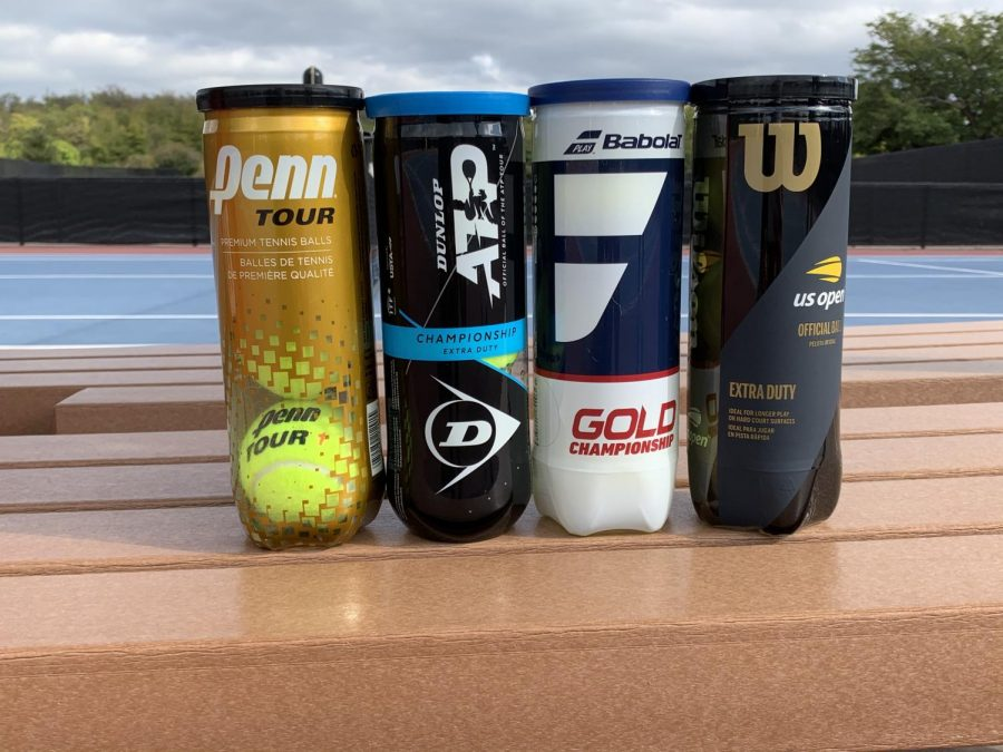 A display of the four tennis ball brands, Wilson, Penn, Babolat, and Dunlop before they are put through their test.