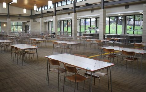 The tables with Plexiglass  are set up in the FDP, spaced 6 feet apart and four students per table.