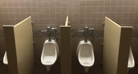 Of the four urinals in the picture, only two of them should be in use at any given time. Preferably, the two outer urinals.