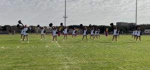 Varsity cheerleaders perform at an outdoor pep rally during Spirit Week.