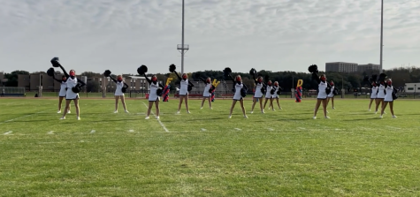 Varsity cheerleaders perform at an outdoor pep rally during Spirit Week.