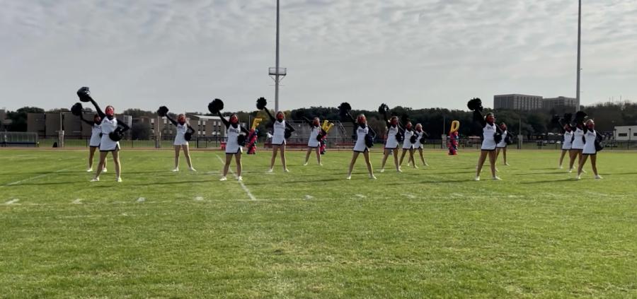 Varsity+cheerleaders+perform+at+an+outdoor+pep+rally+during+Spirit+Week.