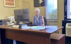 Rita Zawalnicki at her desk in the office.  Photo by Lisa Wallace.