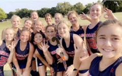 Varsity teammates pose for a selfie after a game.